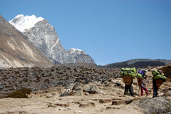 Resting porters. Porters resting during their way to Mount Everest base camp Royalty Free Stock Image