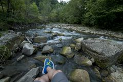 Resting on rocks near a river Stock Photography