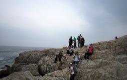 resting on the rocks in SHENZHEN Stock Photo