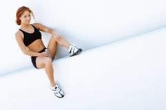 Resting Runner. Beautiful young women runner resting after work out royalty free stock image