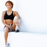 Resting Runner. Beautiful young women runner resting after work out royalty free stock images