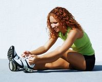 Resting Runner. Beautiful young women runner resting after work out stock image