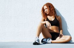 Resting Runner. Beautiful young women runner resting after work out royalty free stock photo