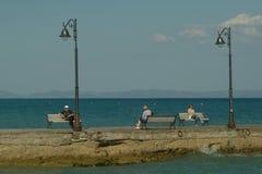Resting on the sea quay Stock Photos