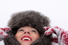 Resting on the snow. Young smiling woman resting on the snow Stock Photos