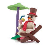 Resting snowman. On white background Royalty Free Stock Image