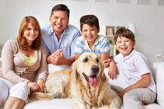 Resting on sofa. Cute boys, their parents and dog resting on sofa at home Royalty Free Stock Images