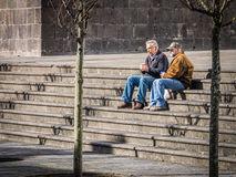 Resting on stairs royalty free stock photography