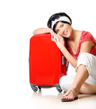 Resting on a suitcase Royalty Free Stock Photography