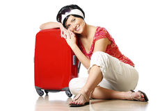 Resting on a suitcase Stock Images