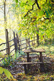 Resting table with water pot. In backyard in the morning light Stock Image