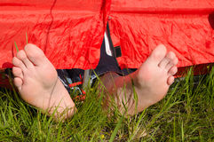 Resting in tent. Man Resting in tent at geen lawn Royalty Free Stock Photo