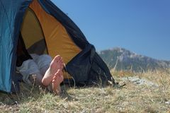 Resting in a tent. Hiker resting in a tent Stock Photo