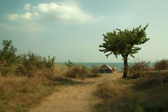 Resting with a tent by the sea stock images