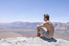 Resting at top of summit in desert Royalty Free Stock Image