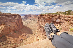Resting tourist legs on top of a mountain. Stock Photography