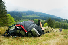 Resting tourist in mountains. Resting tourinst in mountains with cellphone Stock Photography
