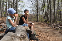 Resting on the trail. Eating an apple in the break. Royalty Free Stock Photography