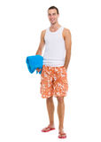 Resting on vacation guy holding blue towel Royalty Free Stock Images