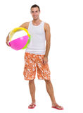 Resting on vacation man with beach ball Stock Photo