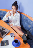 Resting woman with computer Royalty Free Stock Image