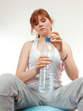 Resting woman keeping bottle of water Royalty Free Stock Photography