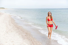 Resting  woman is walking and enjoying at the beach. Stock Photos