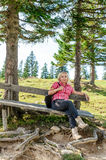 Resting woman on a wooden bench royalty free stock images