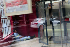 Resting Worker in Shanghai, China. Royalty Free Stock Images