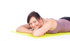 Resting young woman after fitness exercises Royalty Free Stock Image