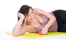 Resting young woman after fitness exercises Royalty Free Stock Photos