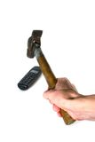 Restive. Bothered phone and hammer in a hand for its destruction Royalty Free Stock Photos