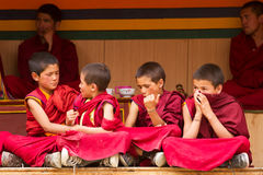 Restless boys monks at the Cham Dance Festiva in Lamayuru stock photography