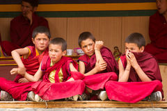 Restless boys monks at the Cham Dance Festiva in Lamayuru stock image