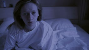 Restless dreams of sleeping woman interrupted by waking up for nightmares