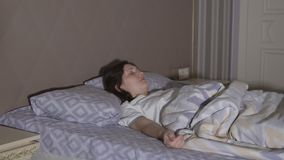Restless dreams. A young woman has a nightmare.  stock footage
