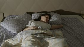 Restless dreams. A young woman has a nightmare. Toned royalty free stock images