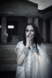 Restless ghost. Gothic girl with arms in chains on an old cemetery royalty free stock photography