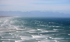 Restless ocean. Ocean view on a windy day with restless waters royalty free stock photos