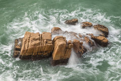 Restless ocean and waves at a rock Stock Images