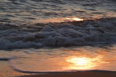 Restless sea, Ionian sea. Beautiful foamy waves of the sea in Greece, the reflection of the sunset in the water of the sea, the waves, the reflection of the stock image
