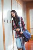 Restless student standing next the locker Stock Image
