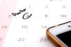 Resto di appuntamento di medico sul calendario Fotografia Stock
