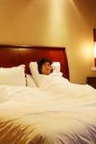 Resto en la cama Imagenes de archivo