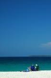 Resto en una playa Foto de archivo libre de regalías