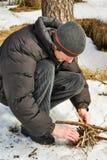 Resto in inverno con legna da ardere Immagine Stock Libera da Diritti