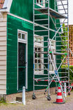 Restoration of an ancient Dutch wooden house Stock Image