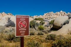 Restoration Area Sign with Desert Rocks Stock Image