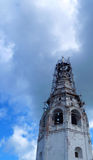 The restoration of the bell tower of the ancient Church. Blue sky Stock Image