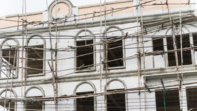 Restoration facade of tall house, scaffolding construction.  Royalty Free Stock Images